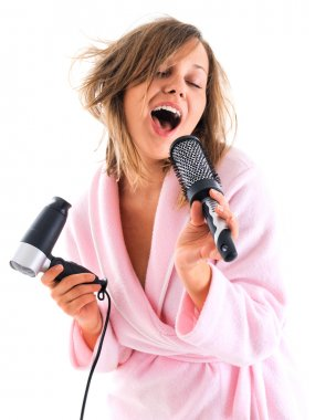 Woman singing with hairbrush