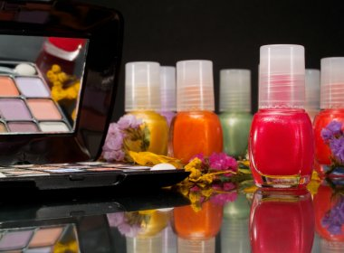 Cosmetics products on  background