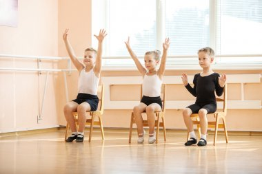Young dancers playing or doing exercise