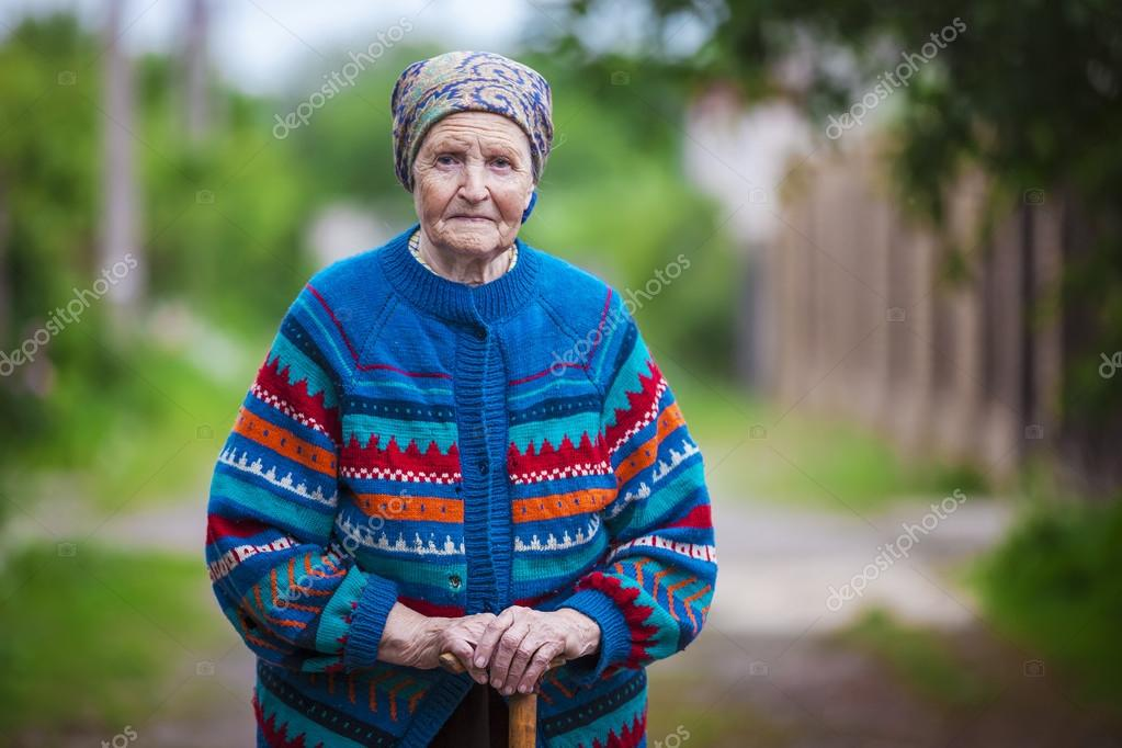 aged woman standing outdoors