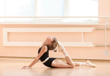 Young dancer doing an exercise
