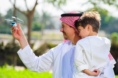 Arabic father and son.