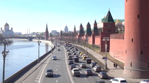 Panoramic shot of Moscow Kremlin embankment with heavy traffic and Moscow river