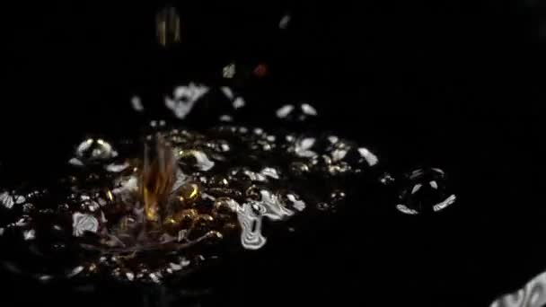 Super Slow Motion Low Light Macro Video Of Drops Falling In Cola Stock
