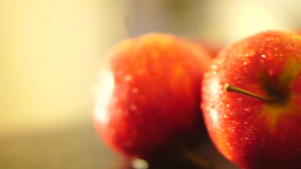 Red apples with drops of water