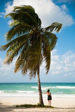 Woman observing Caribbean sea on sandy beach in Varadero on Cuba