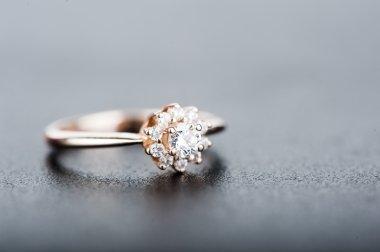 Diamond ring on gray background