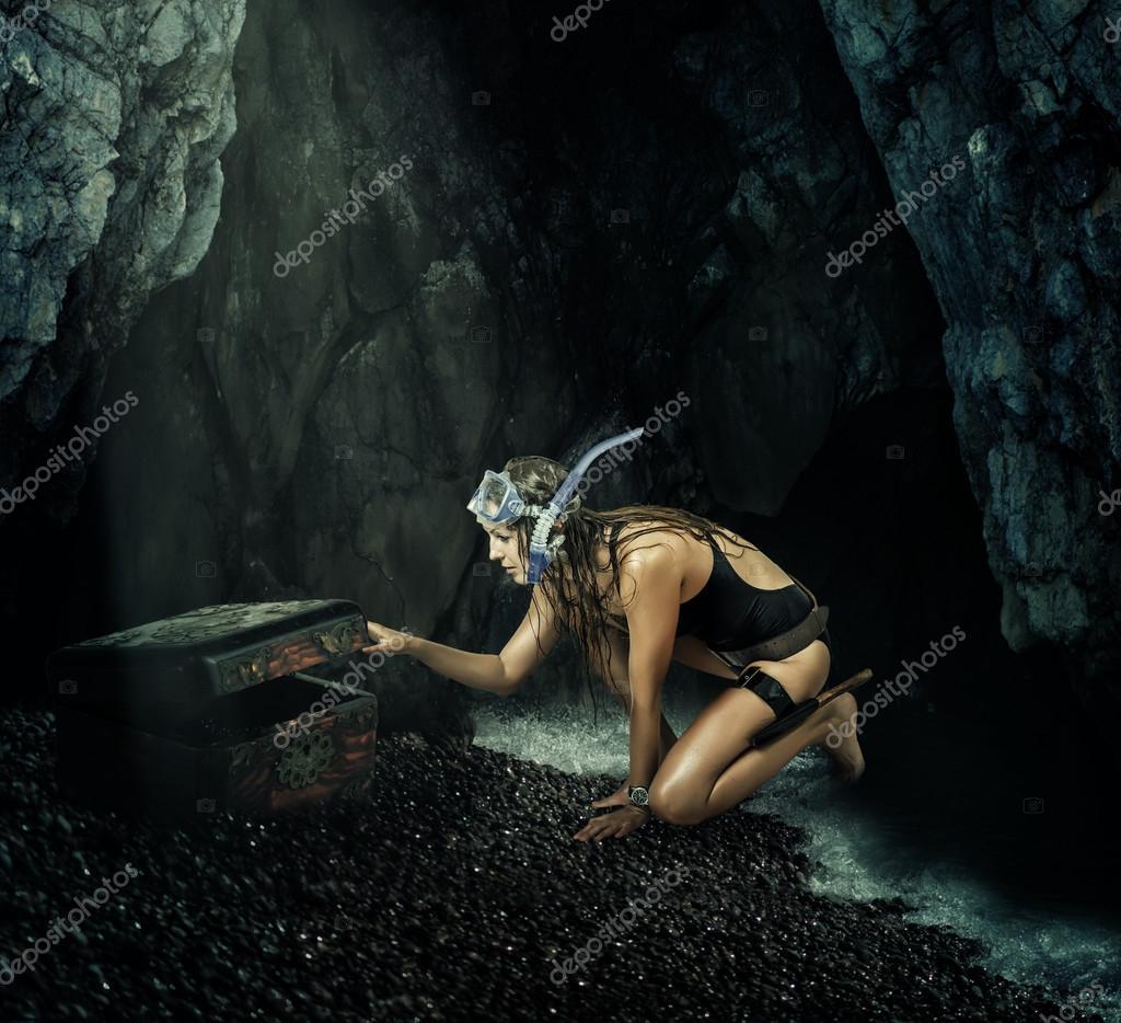 Adventure. Woman opens a treasure chest
