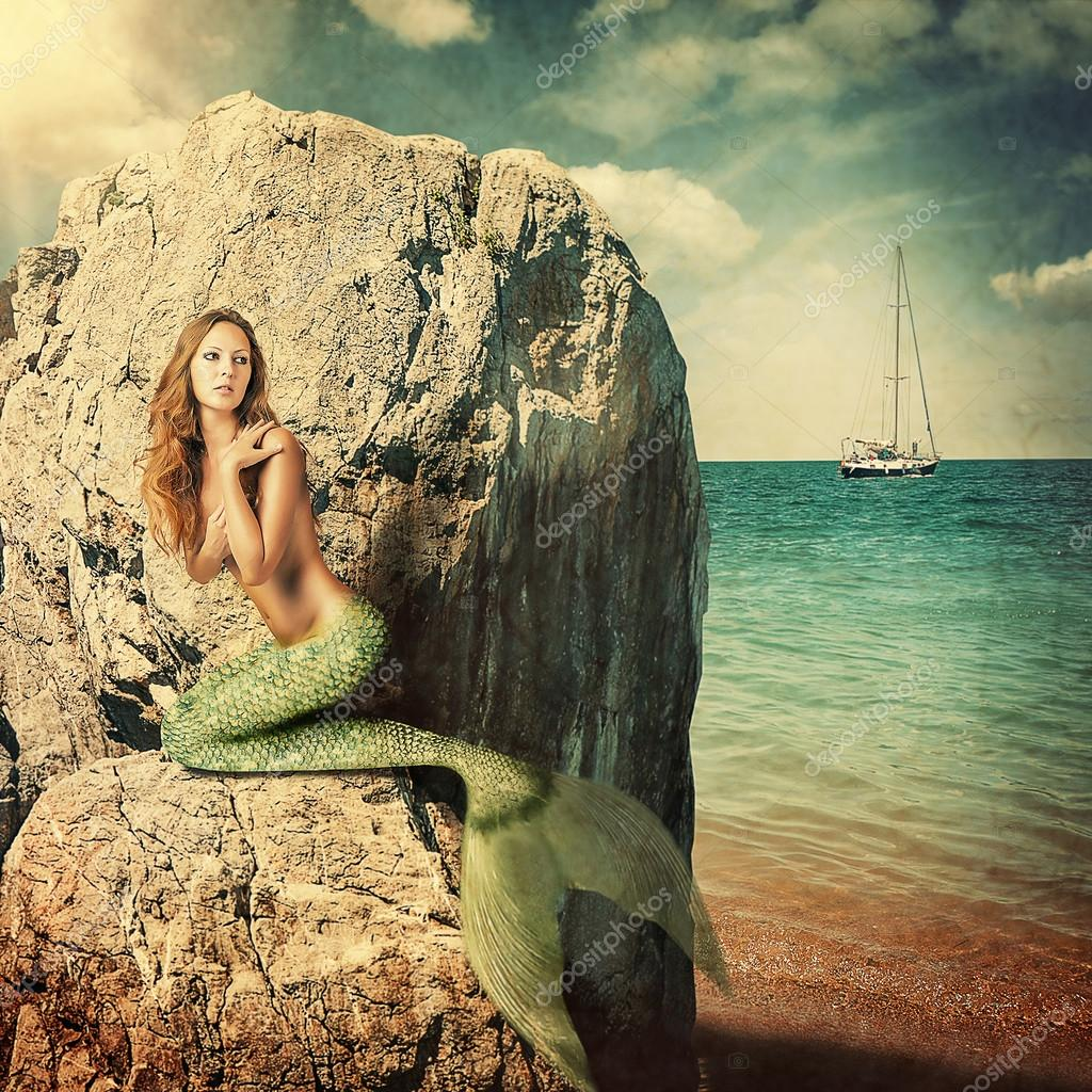 Sexy woman mermaid with long tail