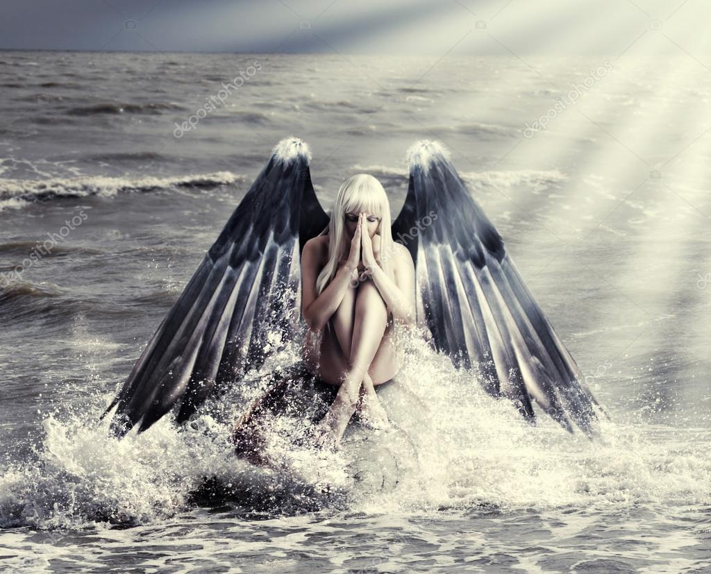 woman with dark angel wings