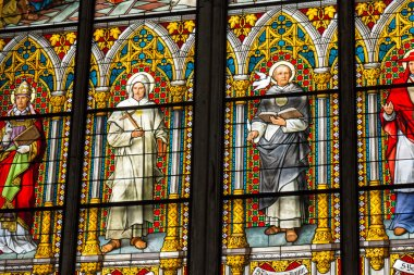 COLOGNE, GERMANY - AUGUST 26: Stained glass church window with Pentecost theme in the cathedral on August 26, 2014 in Cologne