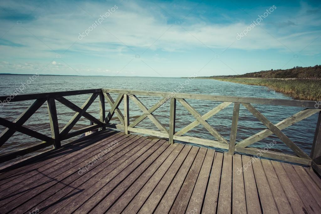 Wooden pier on big lake Lebsko in Poland.