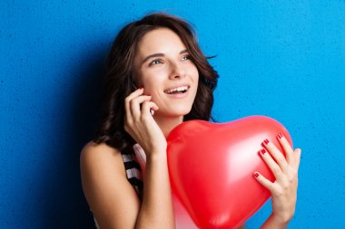 Love and valentines day woman holding heart smiling cute and ado