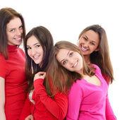 négy mosolygó nő