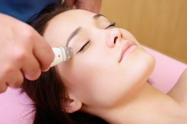 Woman getting rejuvenated treatment