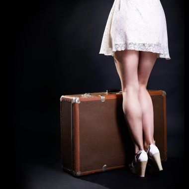 woman  with retro suitcase