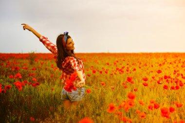 woman   dancing at poppy field