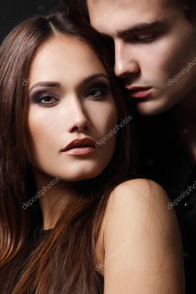 Sexy passion couple, beautiful young man and woman closeup, studio shot  over black — Photo by khorzhevska