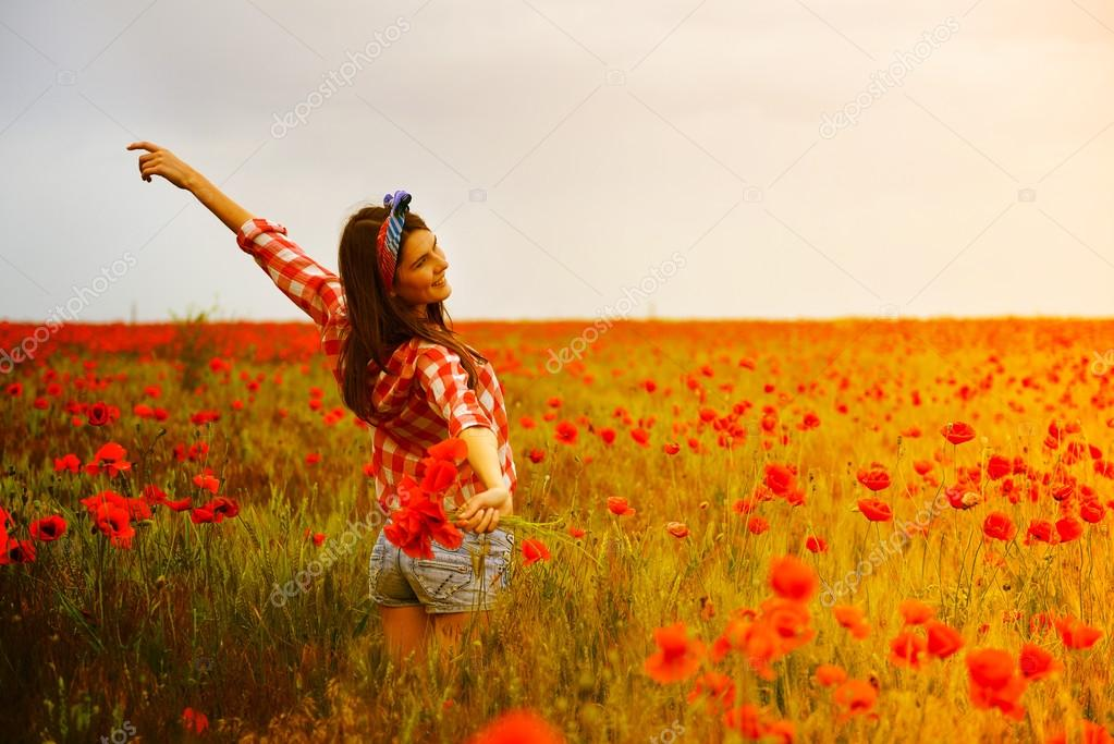 woman   dancing at poppy field