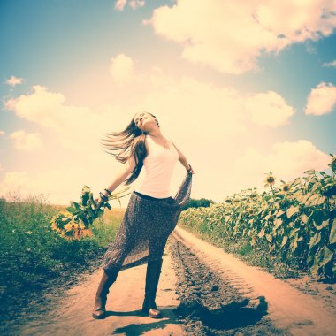 Girl dancing with sunflowers