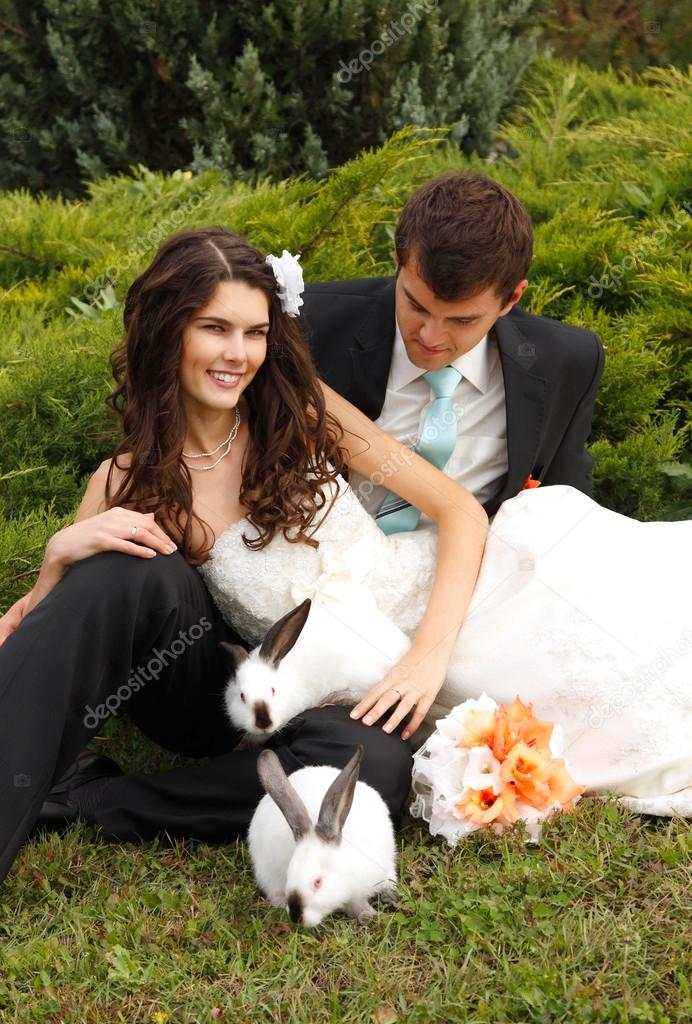 bride with groom  with two rabbits