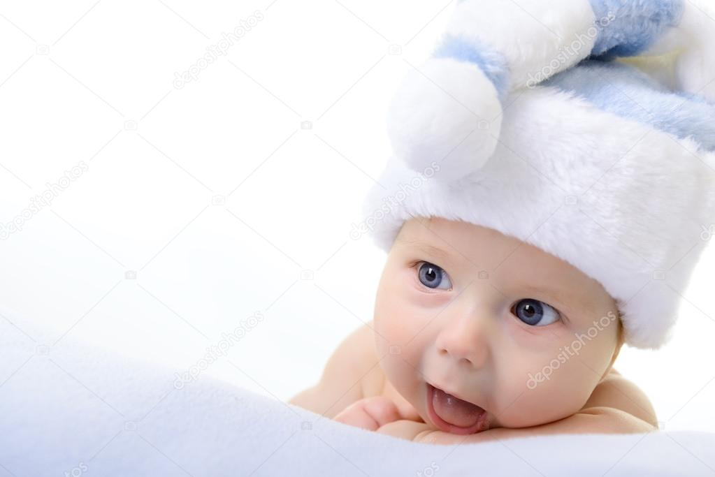 c15bc30a0589 Christmas cute baby boy in Santa's hat lying on blue soft plaid isolated on white  background — Photo by ...