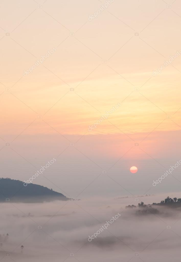 sunrise and mist-covered mountains