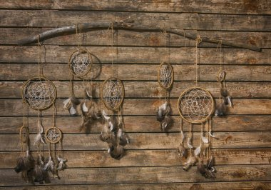 dream catchers hanging on a wooden wall