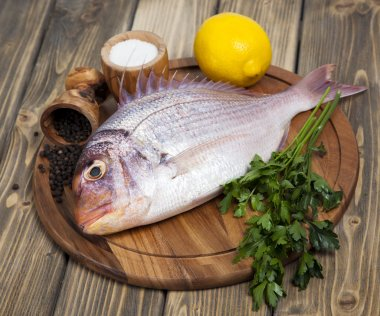 Fresh fish Pagr on a wooden board