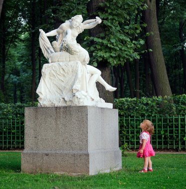 Little girl and  sculpture