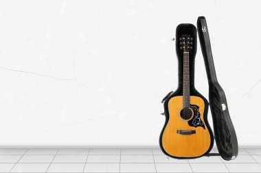 Home interior -  Front view acoustic guitar open hard case of white wall background
