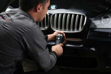 Car service. Polishing of the bumper car