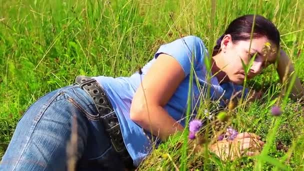 beautiful woman lying on a meadow and dreams