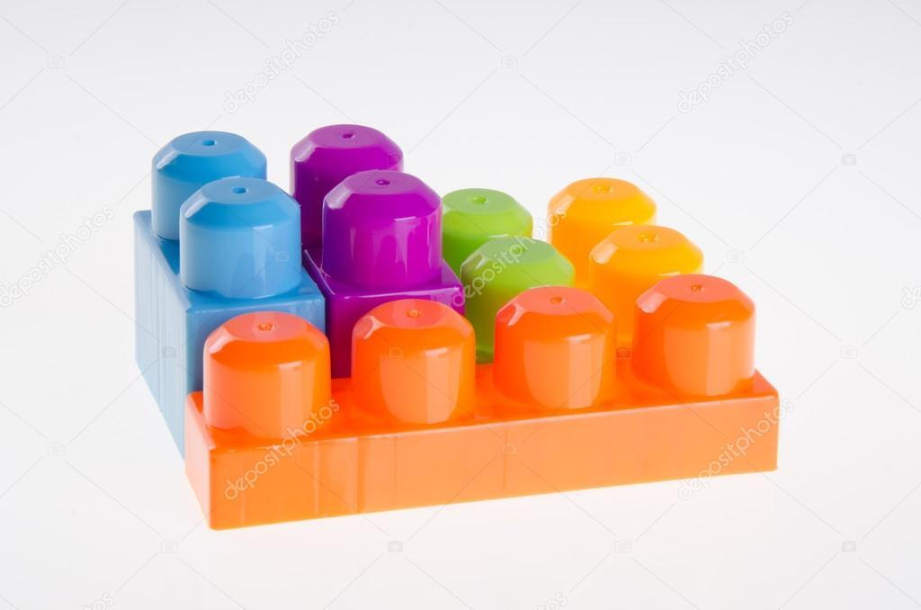 Plastic building blocks on background — Stock Photo © heinteh #79832840