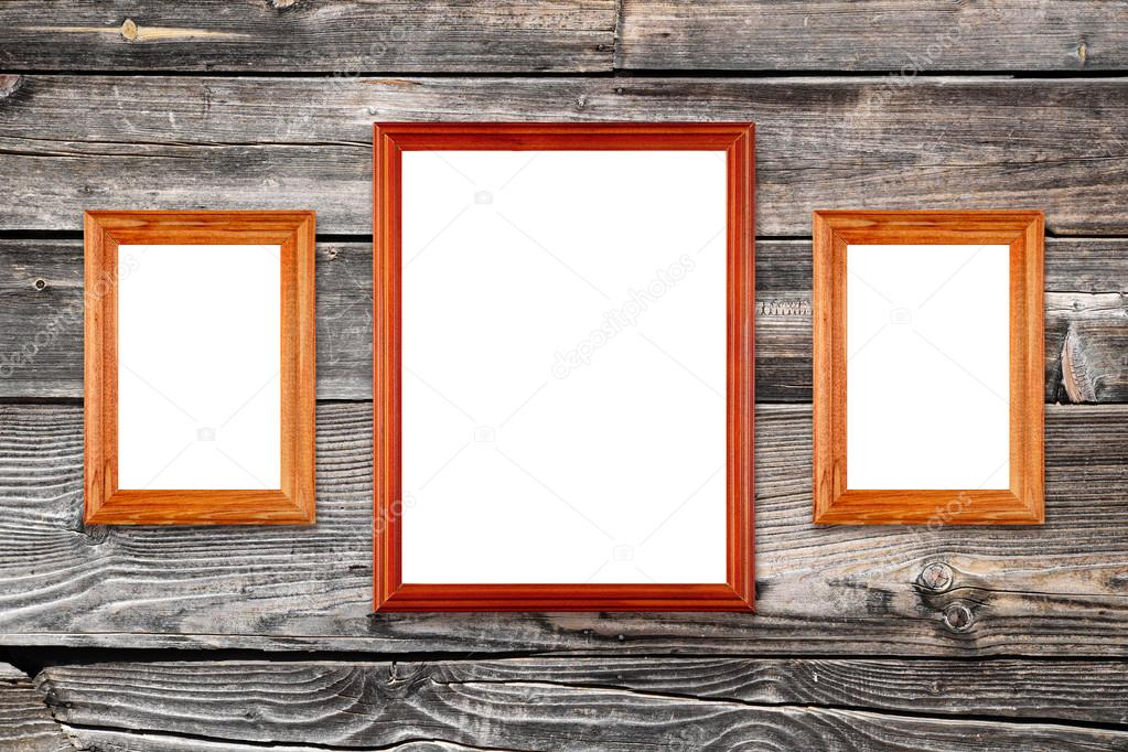Three empty photo frames on old wooden wall — Stock Photo ...