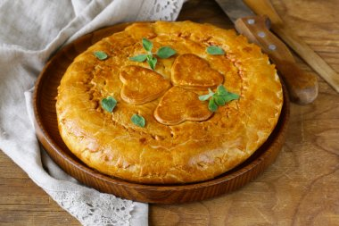 Homemade meat pie with potatoes and oregano