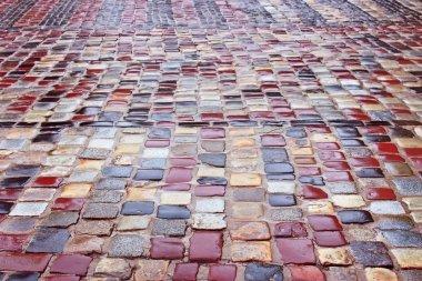 Colour wet cobblestone road in rainy weather