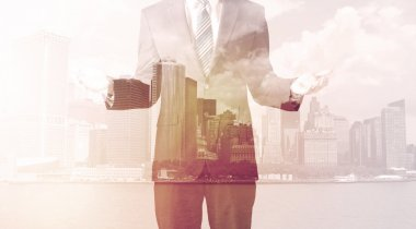 Businessman standing at cityscape background with warm light stock vector