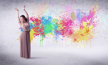 Modern street dancer jumping with colorful paint splashes on back wall concept stock vector