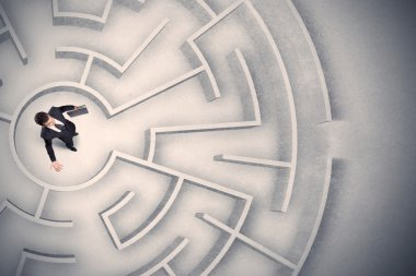 Business man trapped in a circular maze
