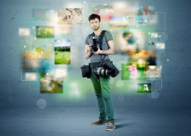 A young amateur photographer with professional camera equipment taking picture in front of blue wall full of faded pictures and glowing lights concept stock vector