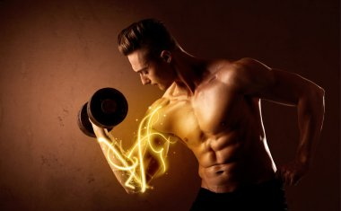 Muscular body builder lifting weight with energy lights on bicep