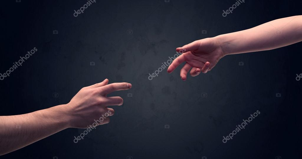 Hand about to touch another one