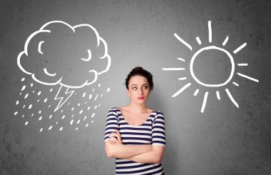 Woman standing between a sun and a rain drawing