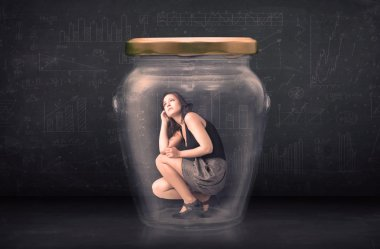 Businesswoman shut inside a glass jar concept