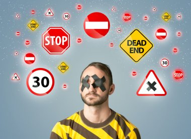 Young man with glued eye and traffic signals