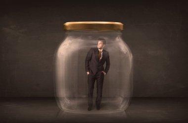 Businessman shut into a glass jar concept