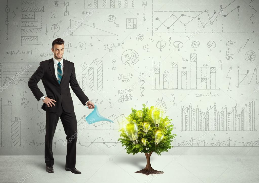 Business man pouring water on lightbulb growing tree