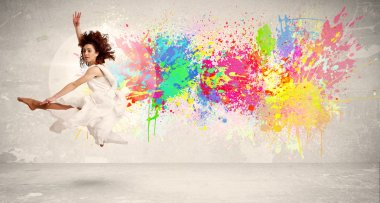 Happy teenager jumping with colorful ink splatter on urban background concept stock vector