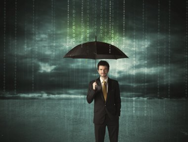 Business man standing with umbrella data protection concept